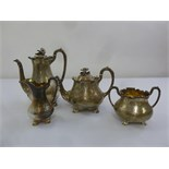 Lot 392 - A Victorian matched silver four piece teaset, pear shaped engraved with flowers, leaves and scrolls,