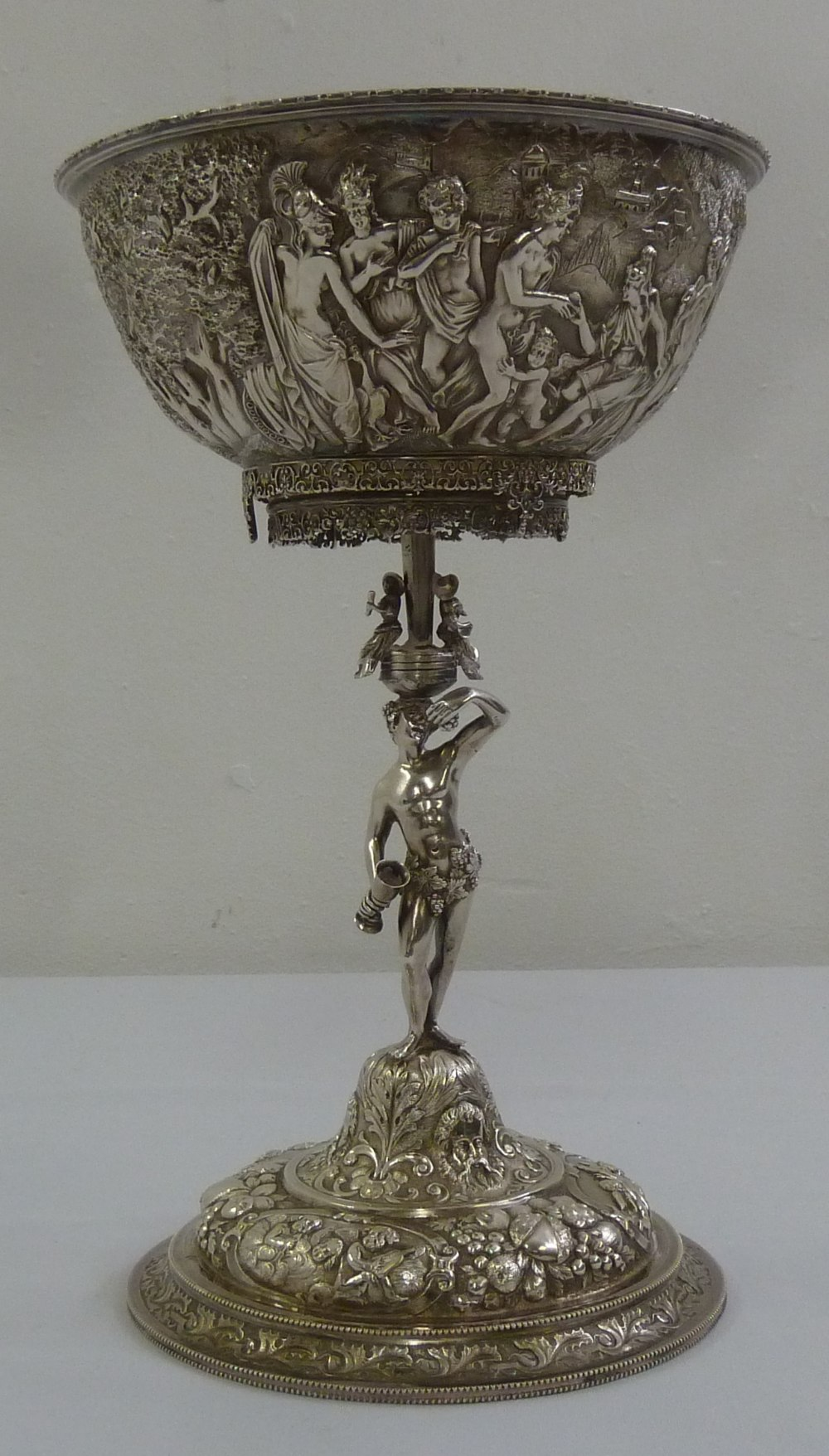Lot 391 - A 19th century Continental white metal centrepiece the bowl heavily chased with classical figures