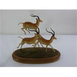 Lot 168 - Louis Paul Jonas limited edition 228/500 porcelain figural group of leaping Springbok, signed to the
