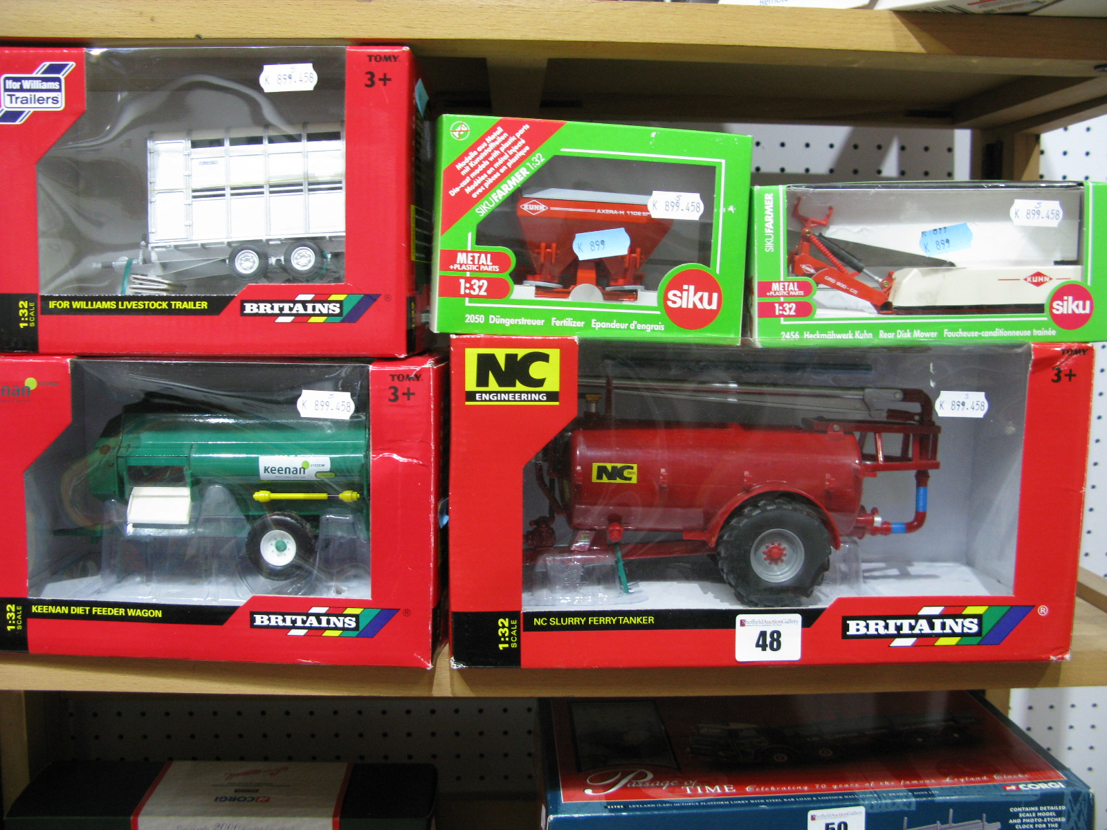 Lot 48 - Five Boxed Britains and Siku 1/32nd Scale Diecast Model Farmyard Trailers and Implements,
