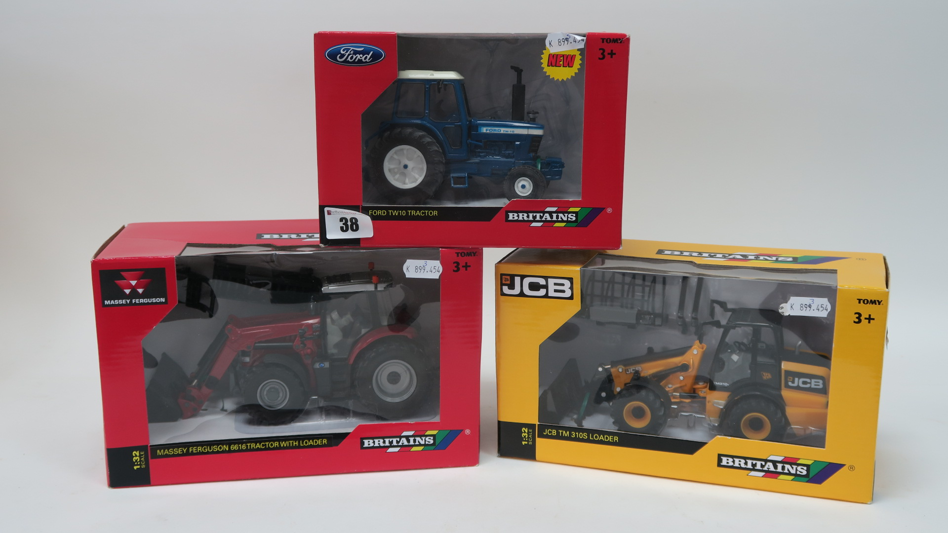 Lot 38 - Three Boxed Britains 1/32nd Scale Diecast Model Tractors, #42839 Ford TW10 Tractor, # 43082AI Massey