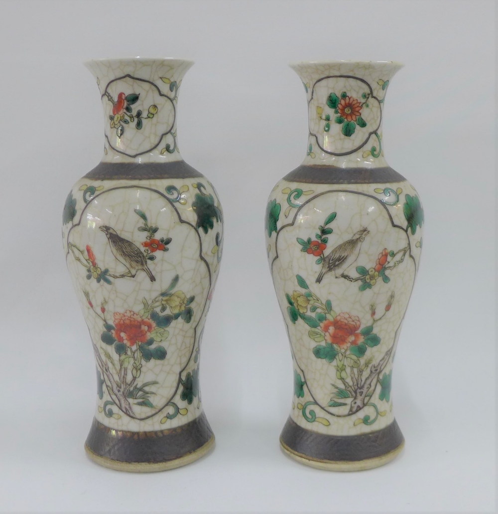 Pair of Chinese high shouldered baluster vases with bird and branch pattern to a craquelure ground