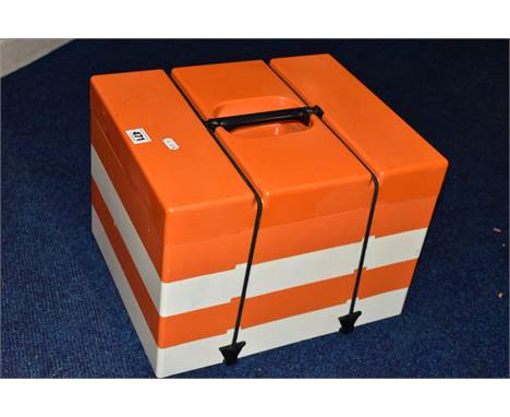 1960'S/70'S ORANGE AND WHITE PLASTIC FOUR TIER PICNIC BOX, each tier with three covered compartments, a tumbler and four piec