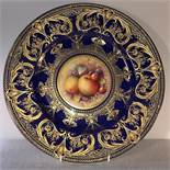 A Royal Worcester fine bone china cobalt blue and gilt overlaid plate, with central hand painted
