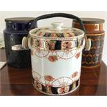 Two Hornsea pottery storage jars and a biscuit barrel.