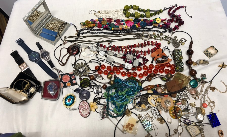 Lot 276 - A large quantity of vintage costume jewellery including Swatch watches, necklaces, earrings etc.