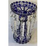 A 19thC blue glass lustre vase. 26cms h.