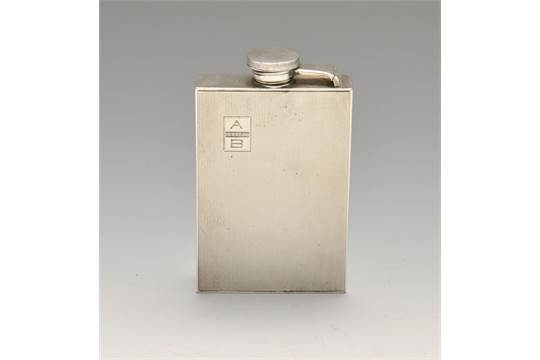 A sterling silver hip flask by Cartier, the rectangular form