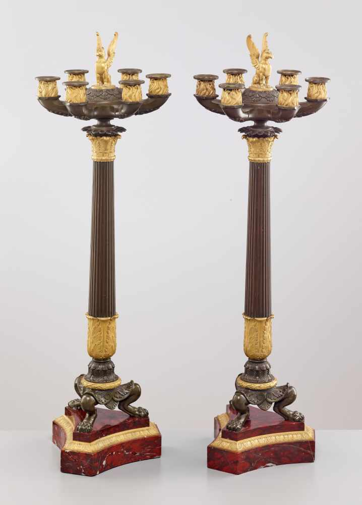 A LARGE PAIR OF CHARLES X BRONZE AND ORMOLU SIX-LIGHT CANDELABRA, 1820sPatinated and fire gilt