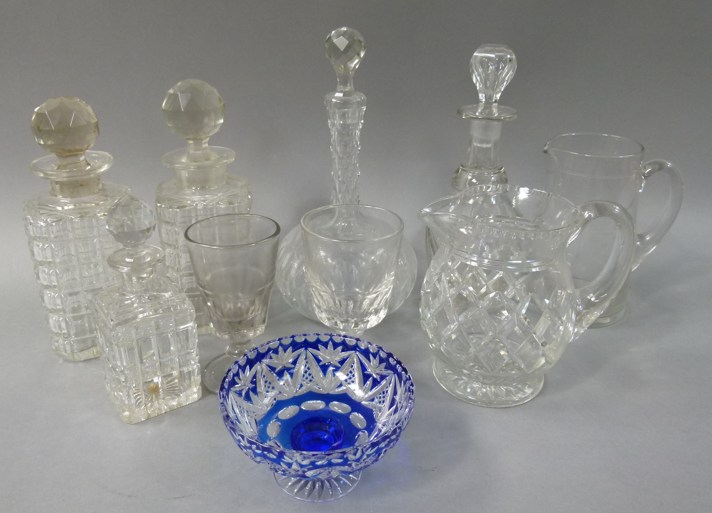 Lot 137 - A pair of decanters with faceted stoppers, two further decanters and a small decanter of square