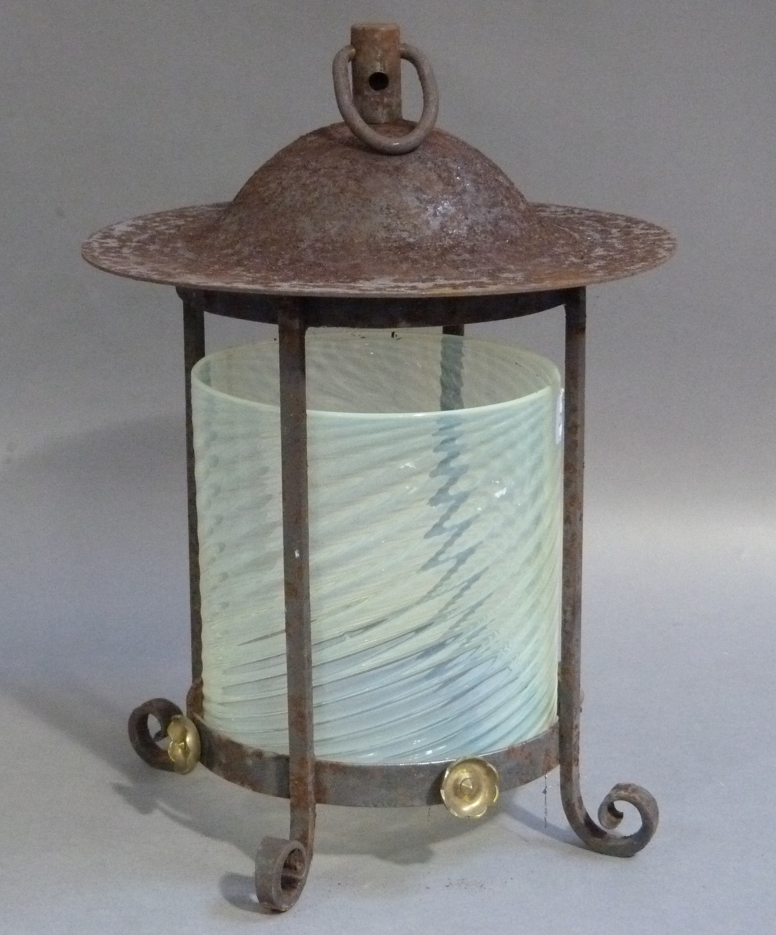 Lot 51 - An iron framed hall lantern with suspension ring post and domed top, the quadruple posted frame with