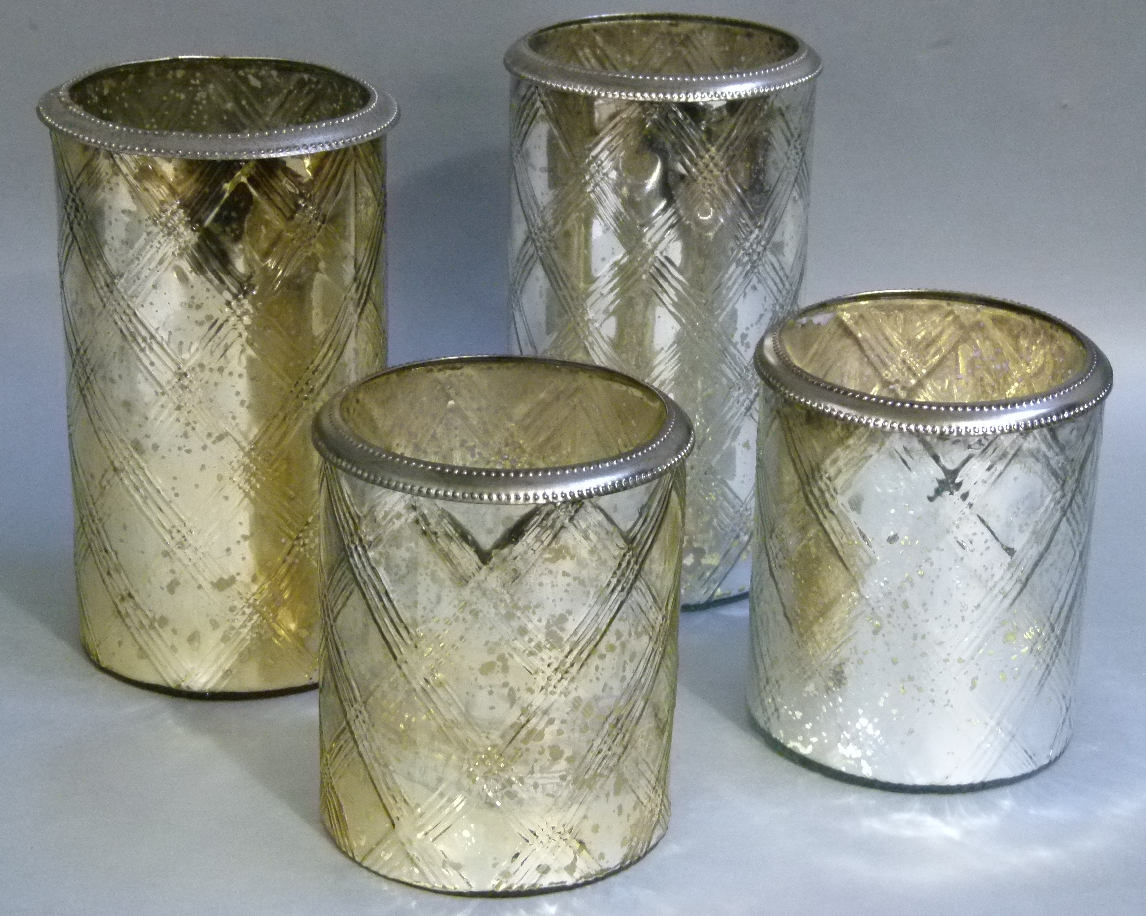 Lot 76 - Two pairs of silvered glass vases of cylindrical form each moulded with criss cross decoration,