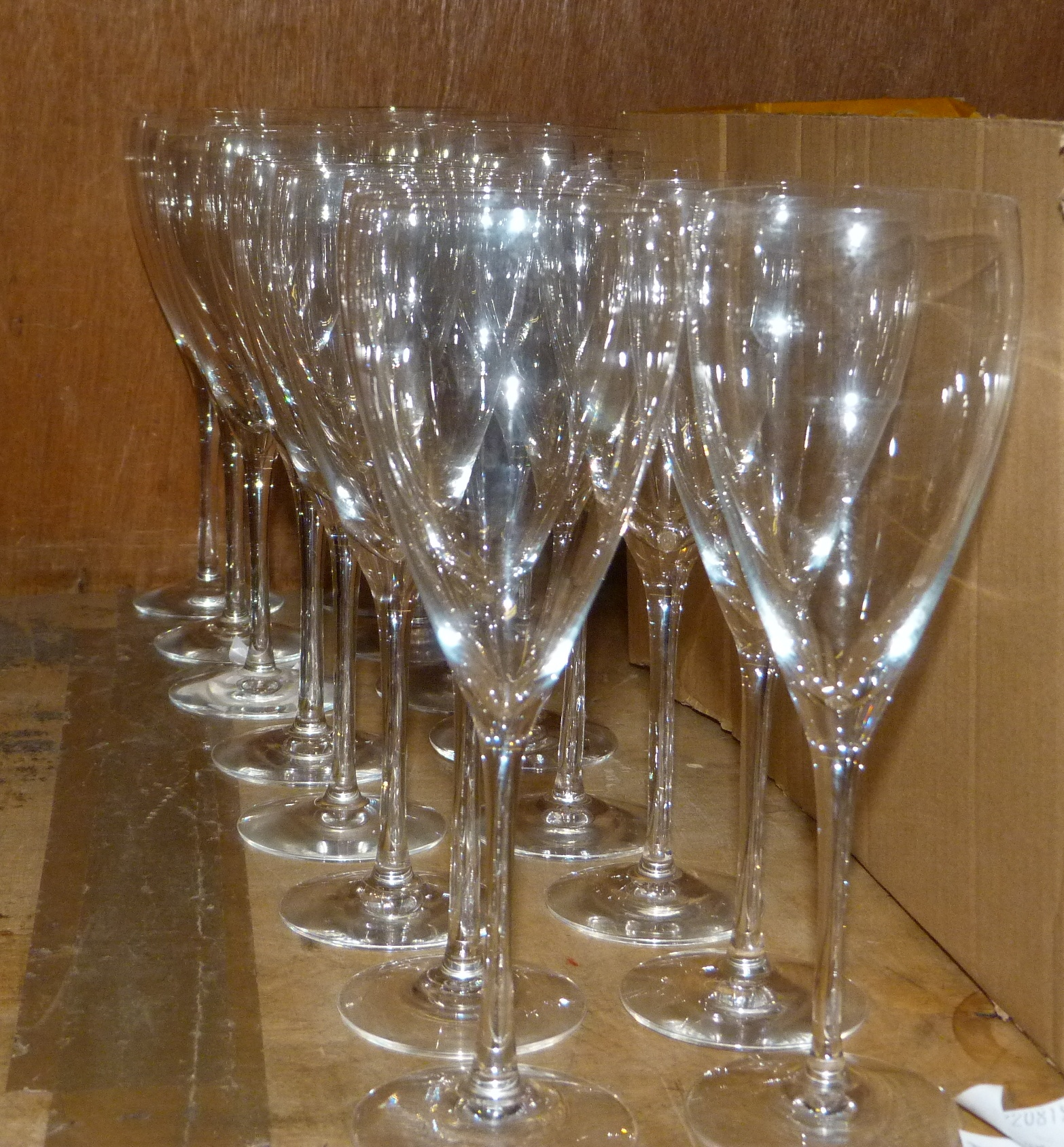 Lot 94 - A set of Orrefors glassware including eight red and eight white wine glasses (16)