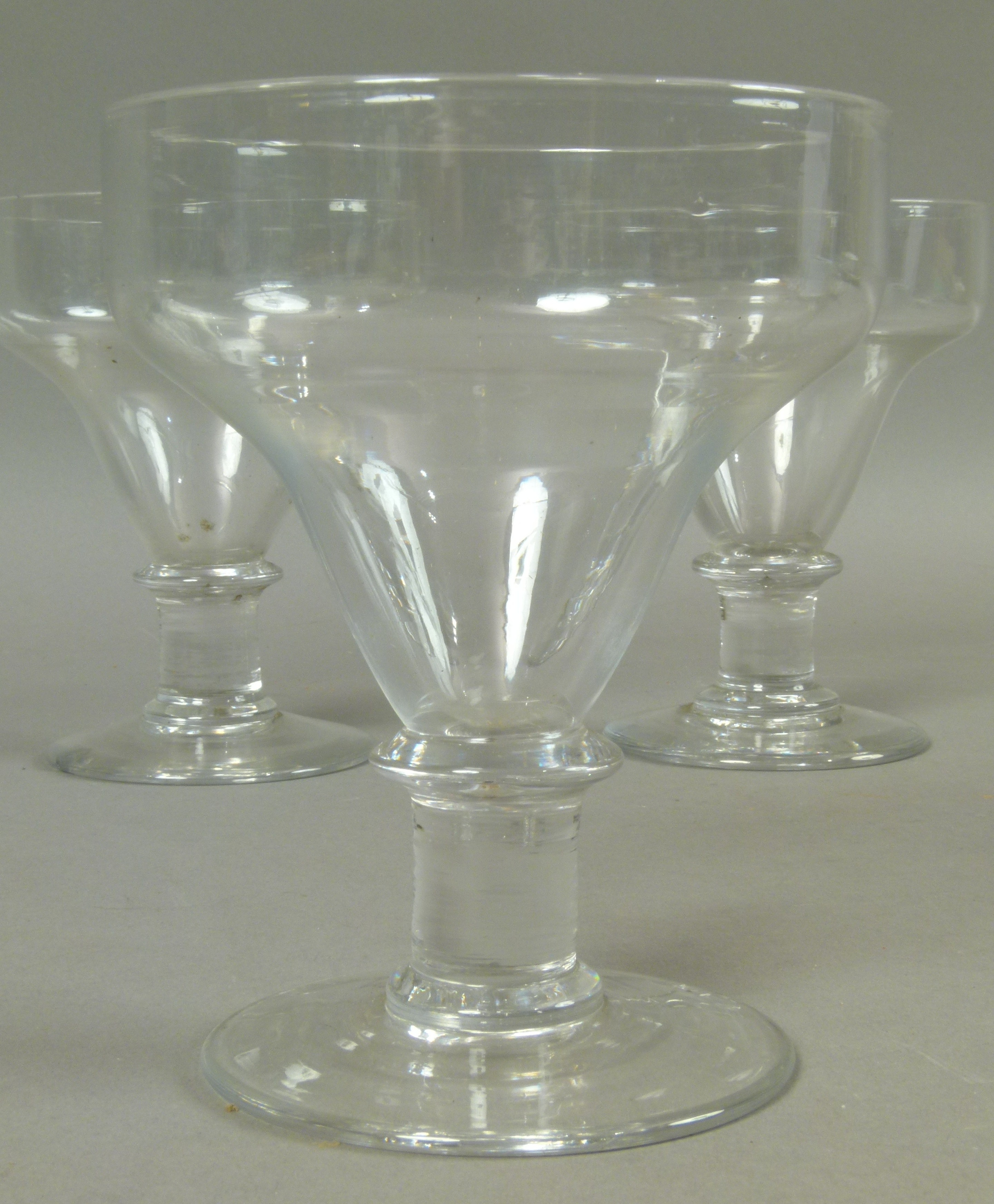Lot 49 - A set of three late Georgian glass rummers c.1820, with plain pan top bowl on capstan stem, 14cm