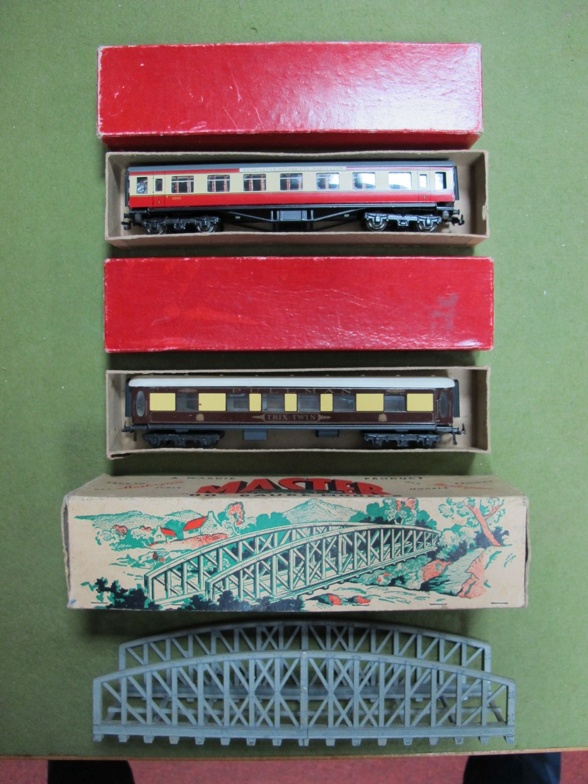 Lot 28 - One Trix 'OO' Pullman Coach and one Trix 'OO' Blood and Custard Coach, 1st. Both boxed, plus a boxed