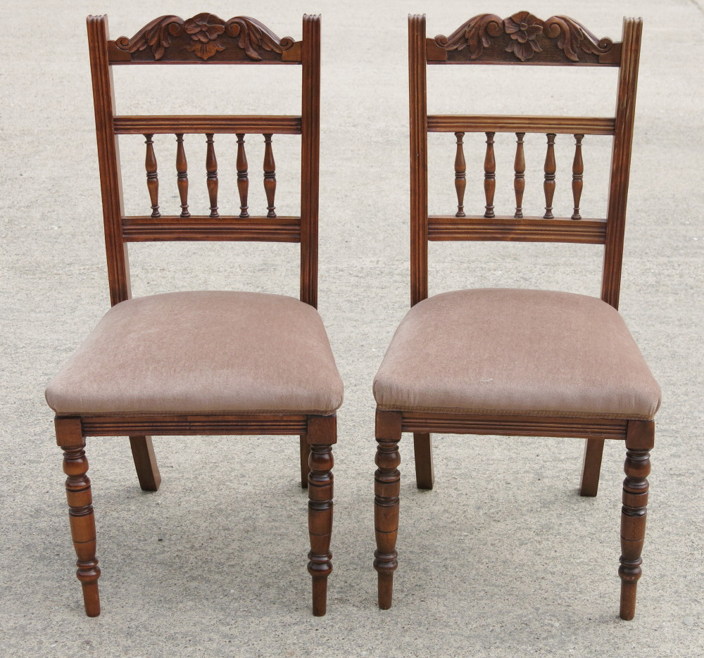 A Set Of Four Victorian Walnut Dining Chairs With Carved