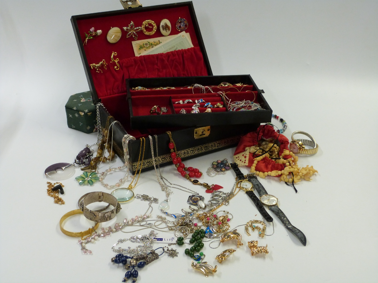 Lot 43 - A large collection of costume jewellery including silver rings, beads, silver necklaces, brooches,