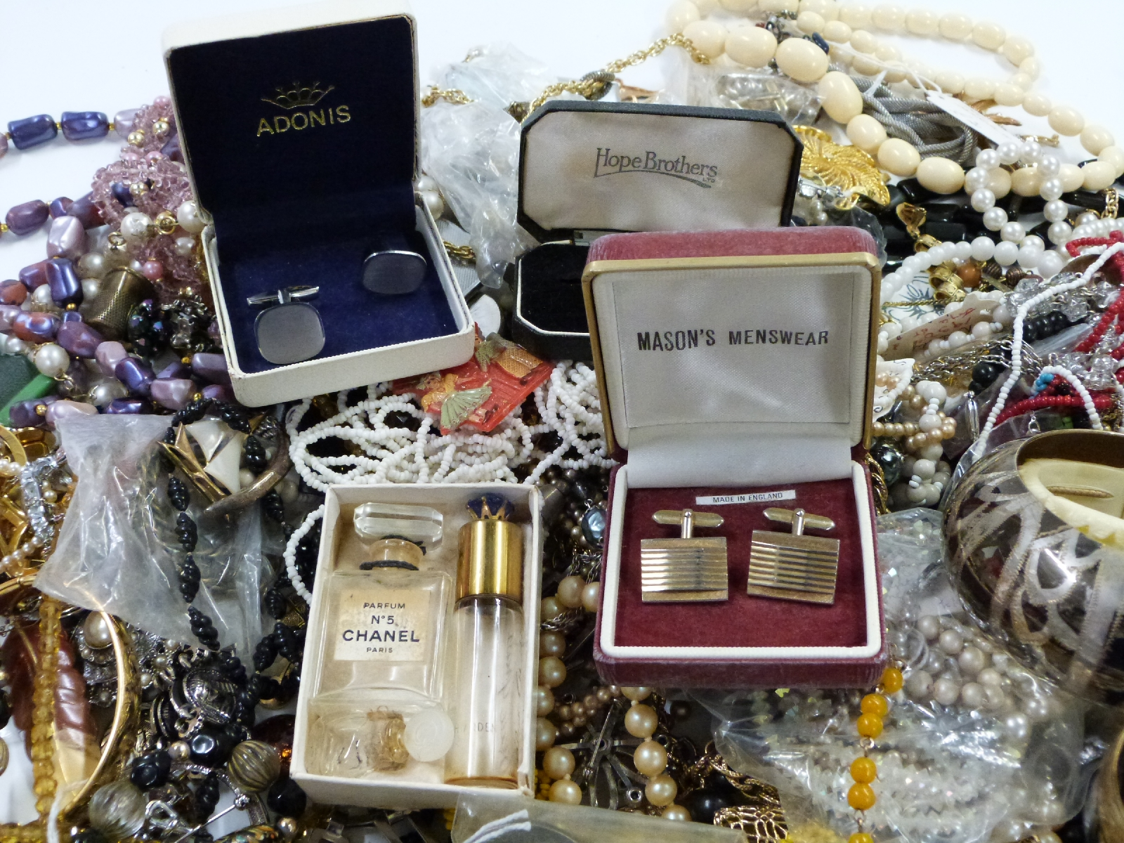 Lot 49 - A collection of costume jewellery to include necklaces, earrings, brooches, compacts, Miracle brooch