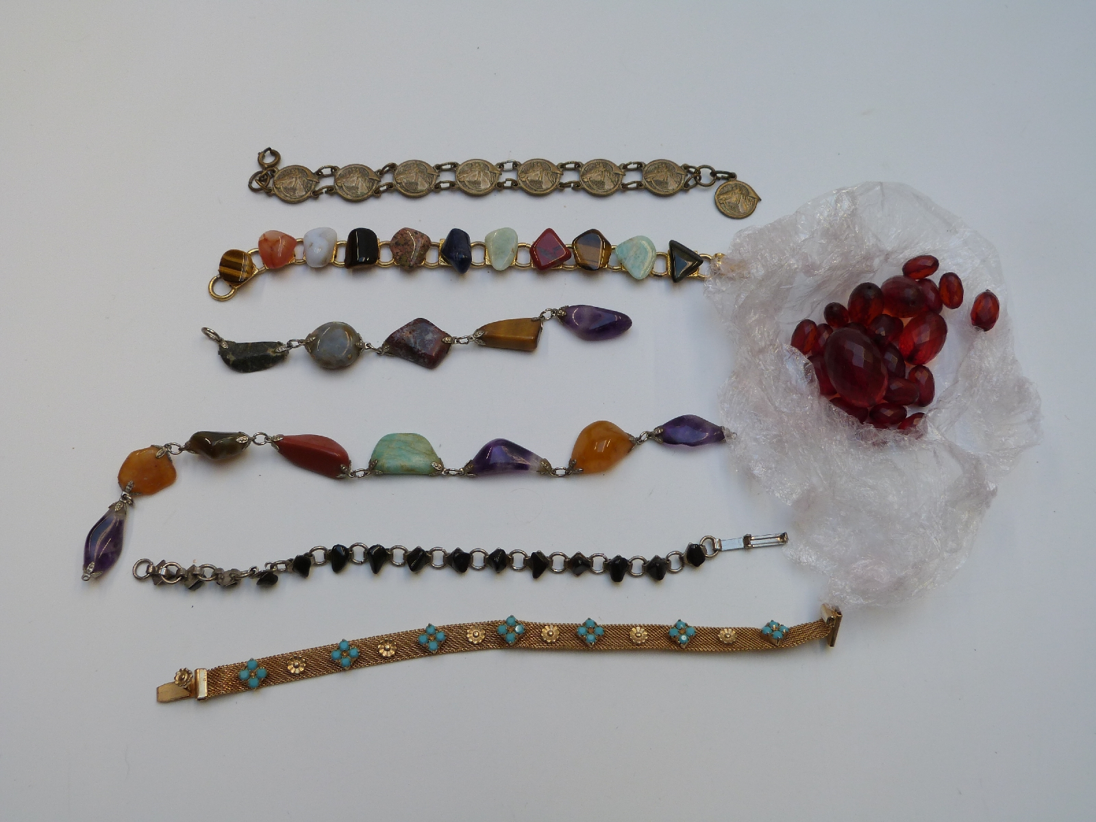 Lot 19 - A collection of costume jewellery including bracelets, tiger's eye pendant, Miracle necklace,
