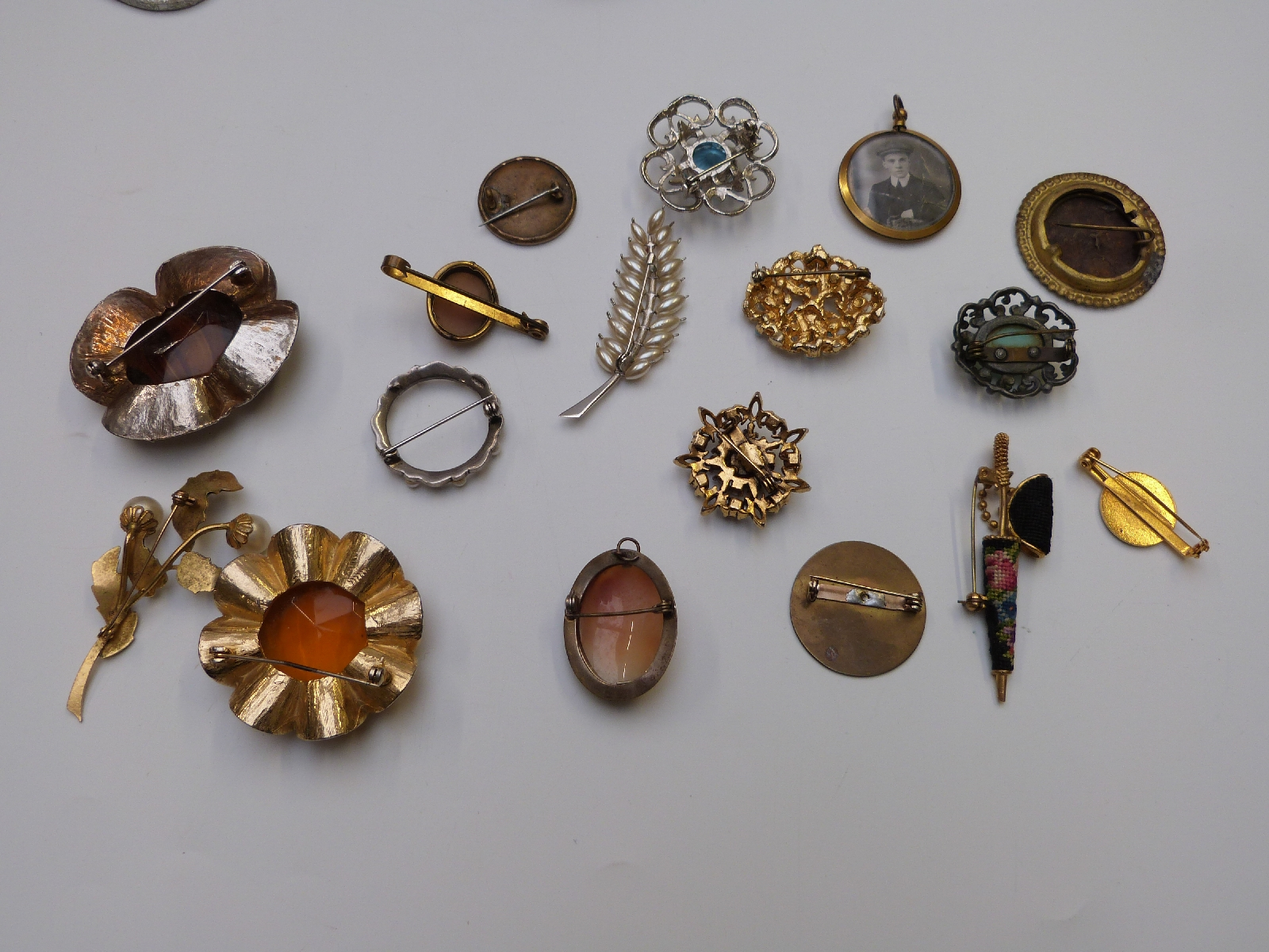 Lot 15 - A collection of costume jewellery including mother of pearl necklace, Victorian cameo brooch, silver