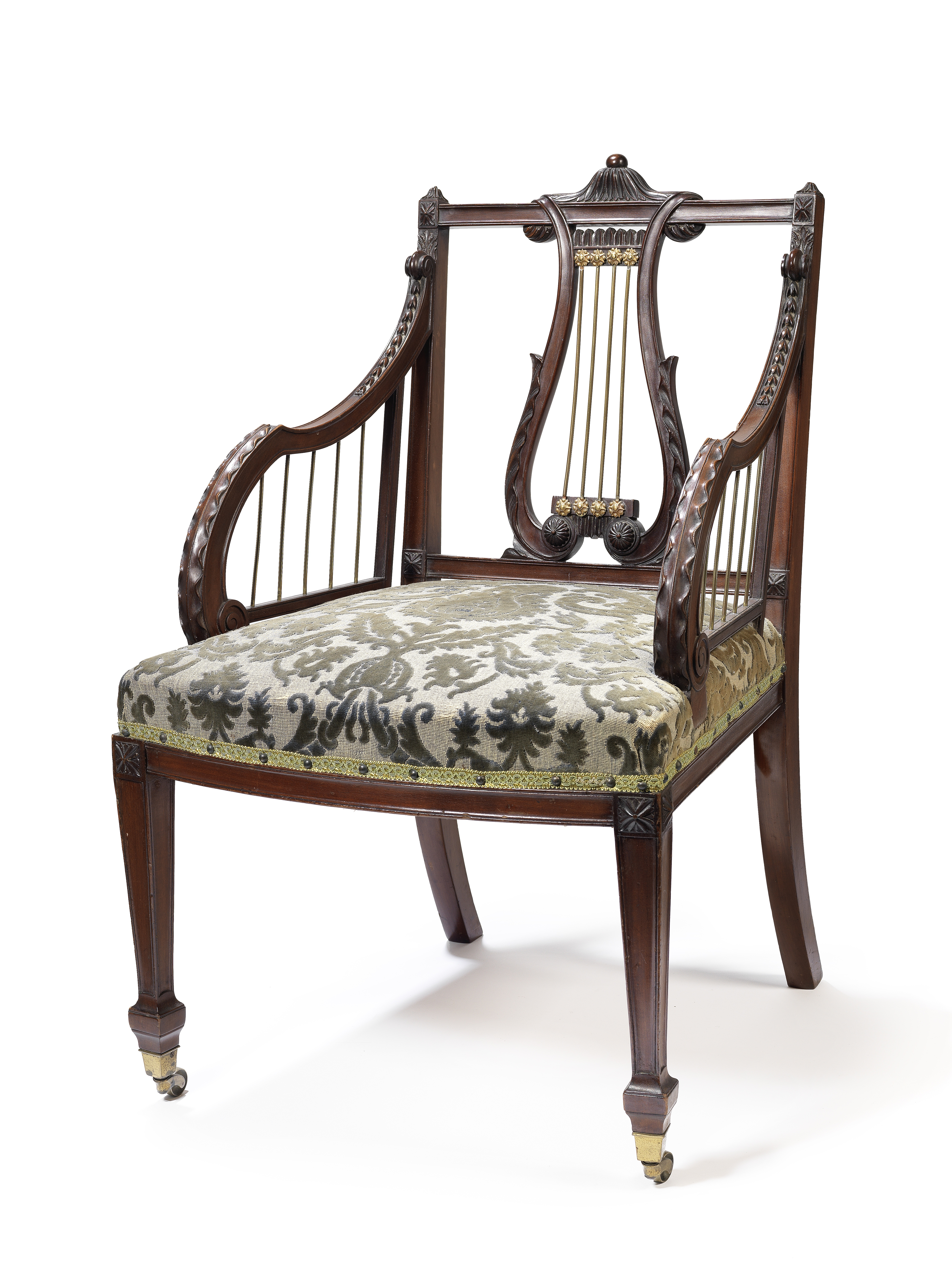 A late Victorian brass mounted mahogany open armchair possibly by Gillows, after a design by John...