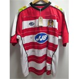 Wigan Warriors, JJB Rugby League Shirt, Signed by the Team. Sponsors Include 'JJB, & Tote Sport'.