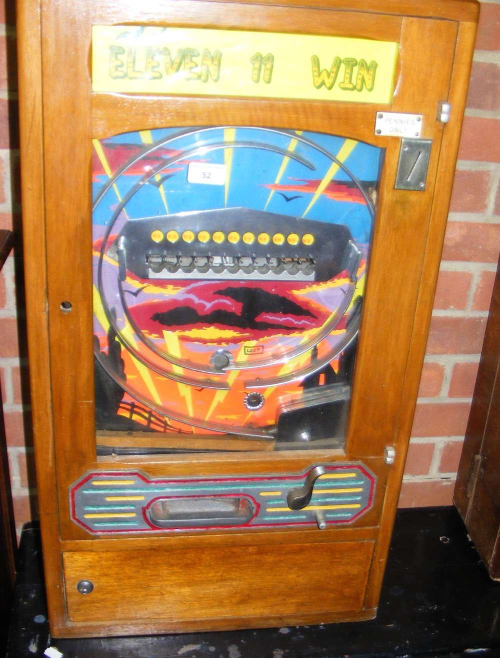 "Lot 52 - A penny in the slot ""Eleven 11 Win"" pinball type amusement arcade machine"