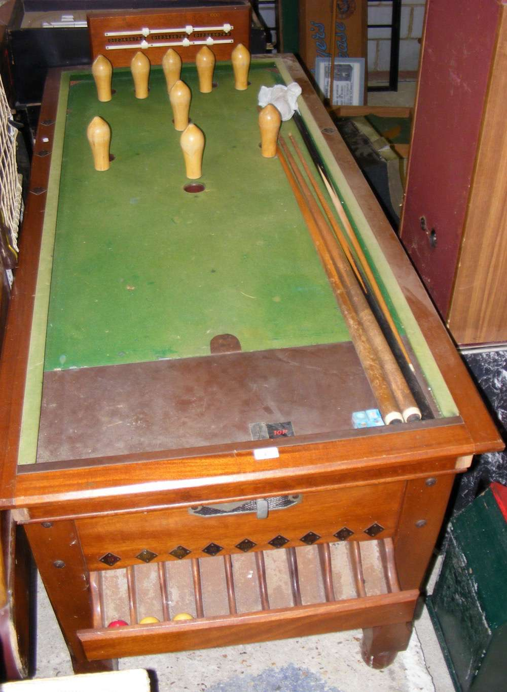Lot 47 - A coin operated bar billiards table - complete with balls and cues