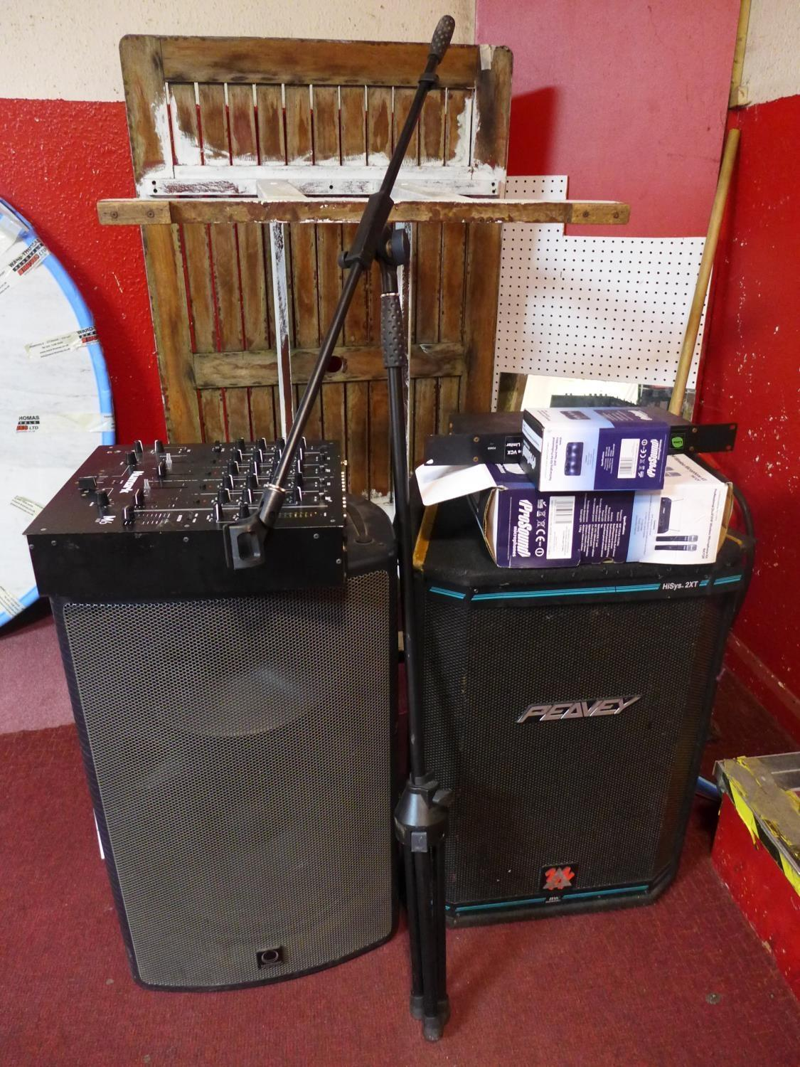 Lot 559 - A Peavey HIsys 2XT speaker together with a turbo sound speaker, a Numark mixer and other items