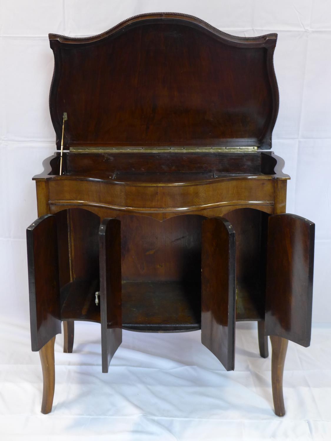 Lot 526 - An early 20th century walnut gramophone cabinet, H.90 W.84 D.50cm
