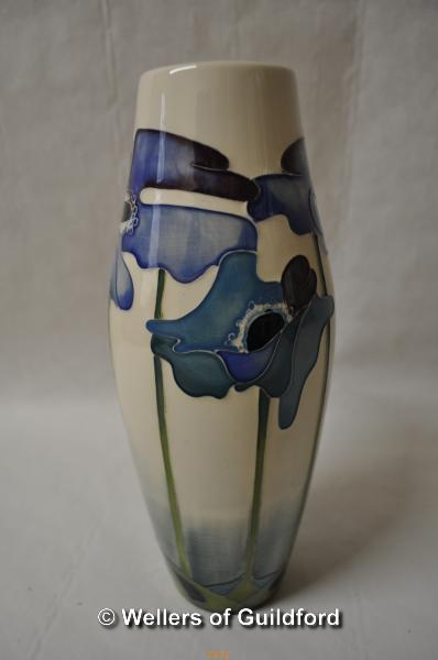 Lot 7471 - Moorcroft baluster vase with tall blue flowers on a white ground, 21cm.