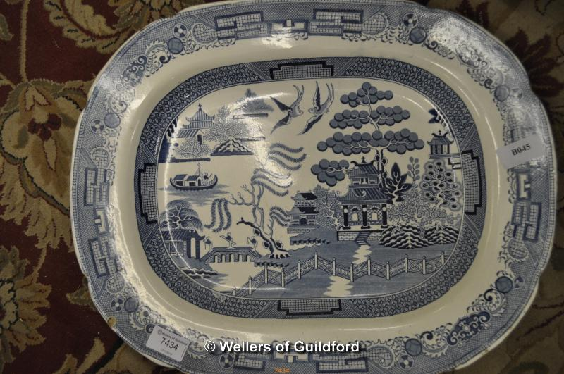 Lot 7434 - A Willow pattern blue and white ironstone meat dish.