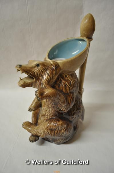 Lot 7416 - A 19th Century Holdcroft majolica jug modelled as a bear, 23cm.