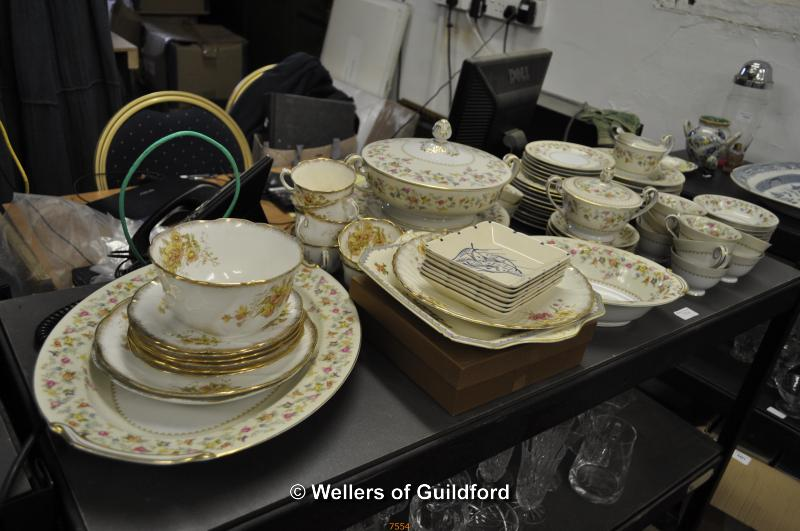 Lot 7554 - A Noritake dinner and tea service decorated with spigs of flowers on a cream ground; together with A