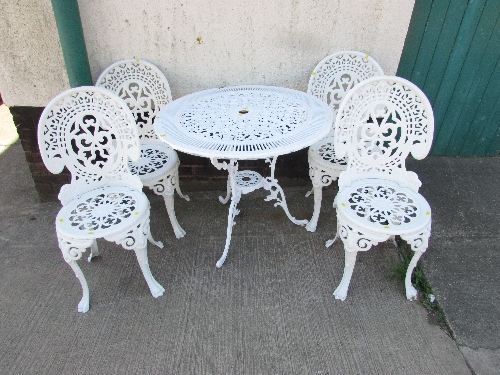 Lot 26 - WHITE PAINTED WROUGHT METAL CIRCULAR PATIO TABLE AND FOUR CHAIRS