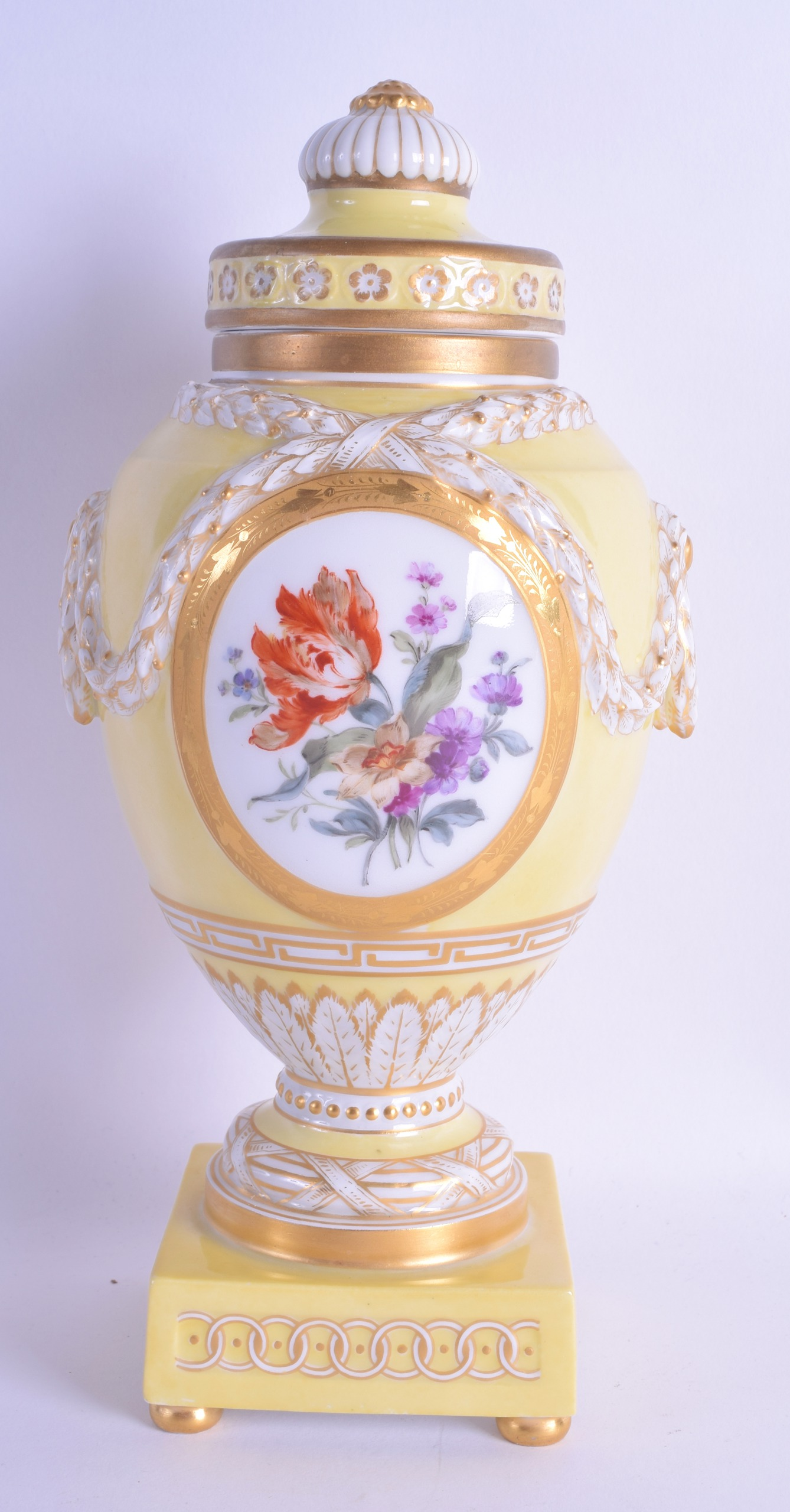 Lot 98 - A FINE 19TH CENTURY KPM BERLIN YELLOW VASE AND COVER painted with two putti amongst clouds. 25 cm