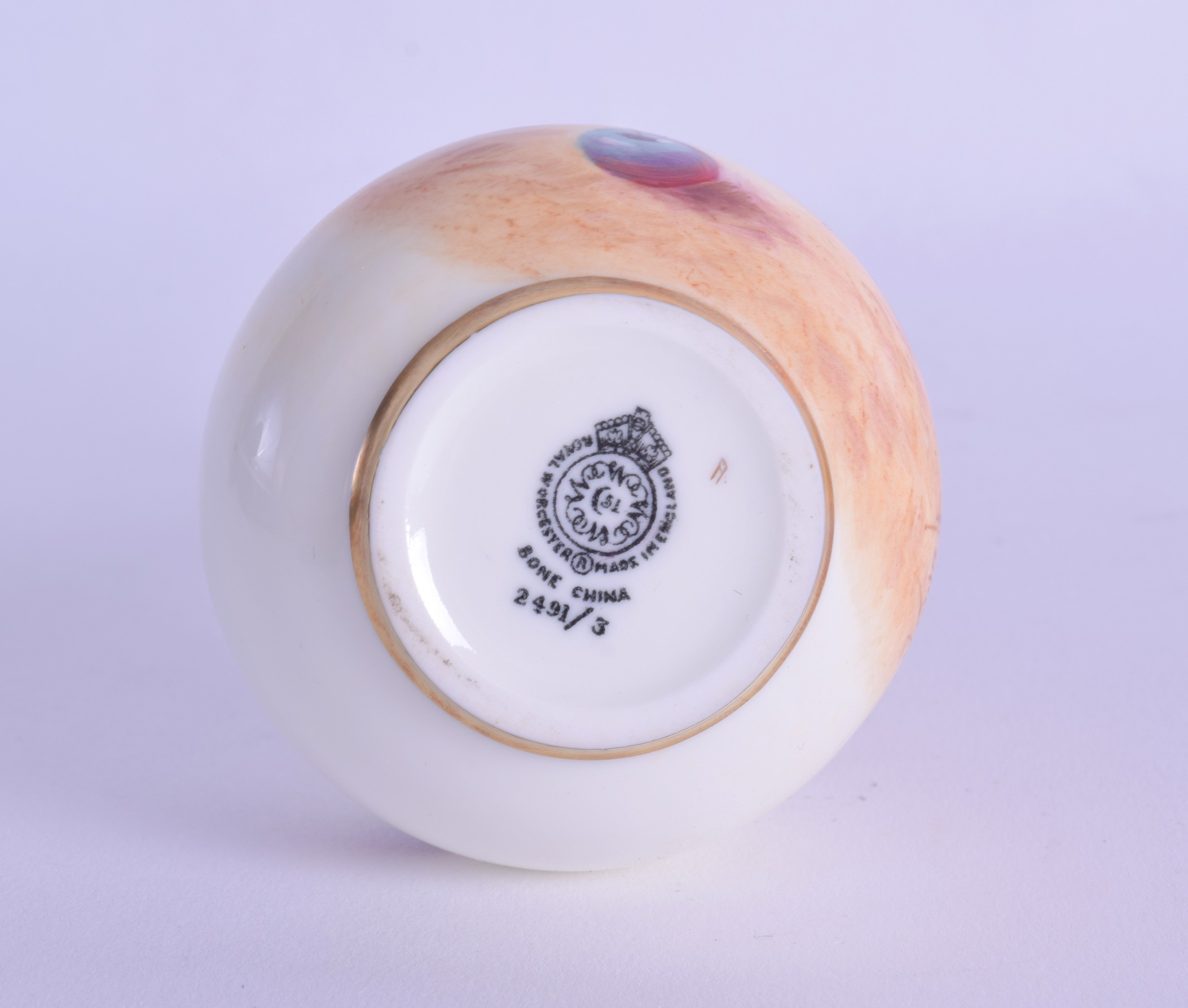 Lot 167 - Royal Worcester vase painted by Roberts with peaches and cherries, black mark. 12.5cm high
