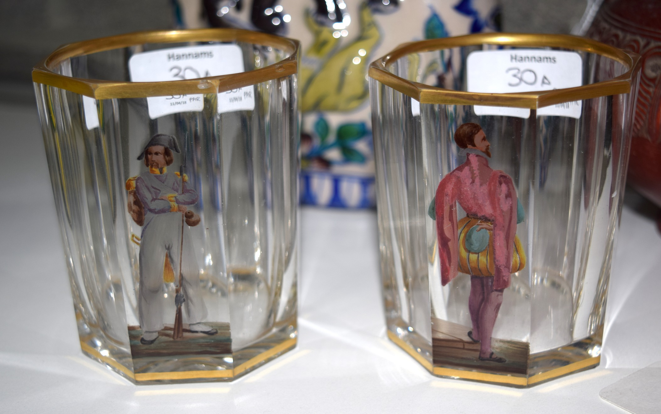 Lot 30A - AN UNUSUAL PAIR OF EARLY 19TH CENTURY AUSTRIAN OCTAGONAL GLASSES painted with a male within a