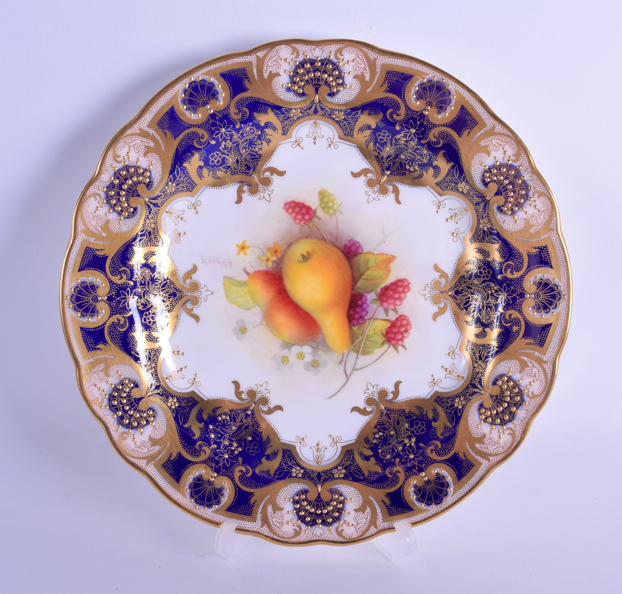 Lot 159 - Royal Worcester plate painted with fruit under a blue and gilt border by Albert Shuck, signed date