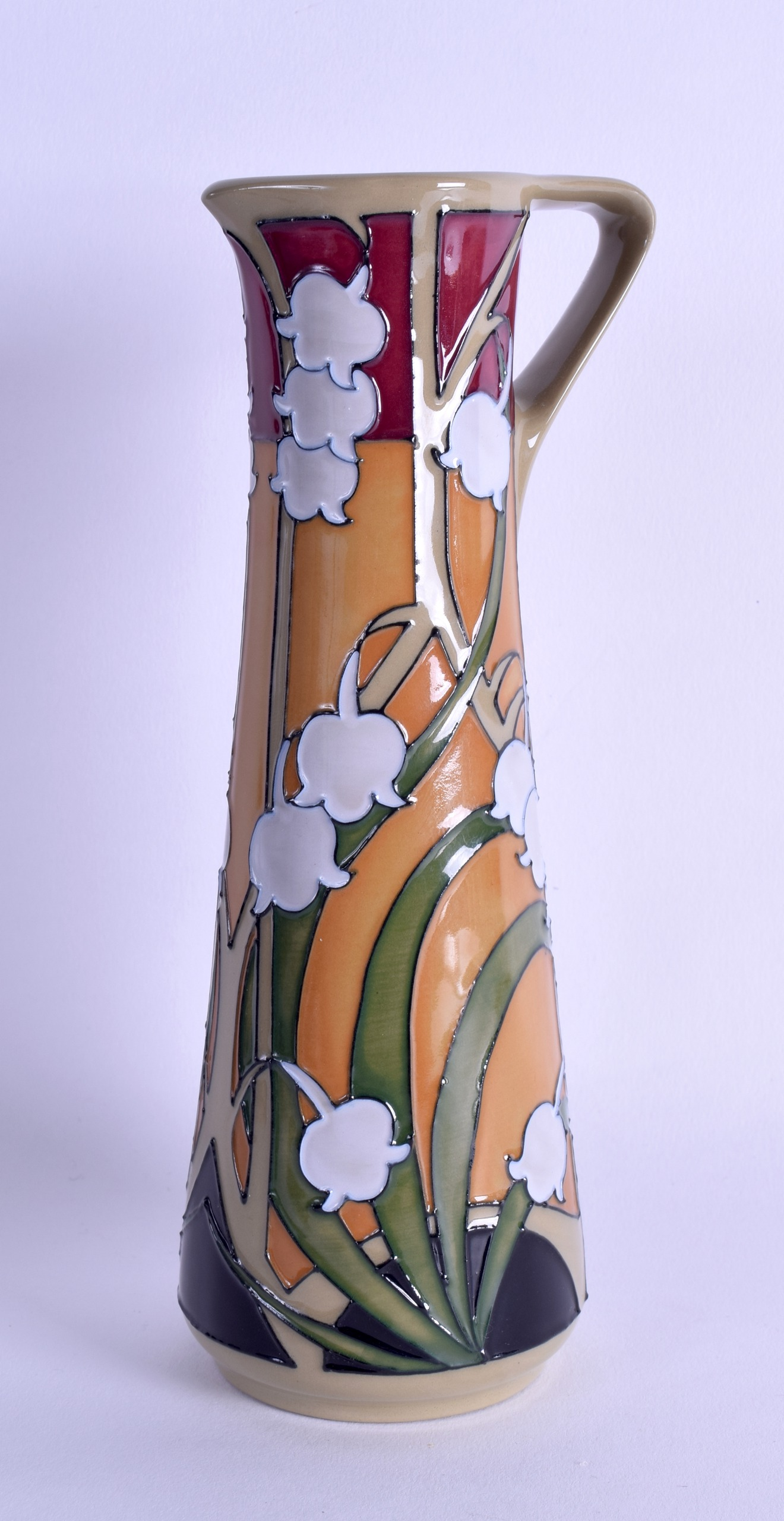 Lot 44 - A MOORCROFT 'LILY OF THE VALLEY' JUG designed by Emma Bossons. 18.5 cm high.