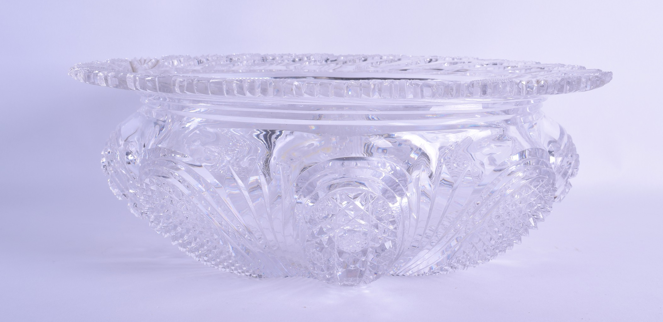 Lot 21 - A FINE QUALITY HEAVY CUT CRYSTAL BOWL decorated with various motifs and scrolling foliage. 30 cm