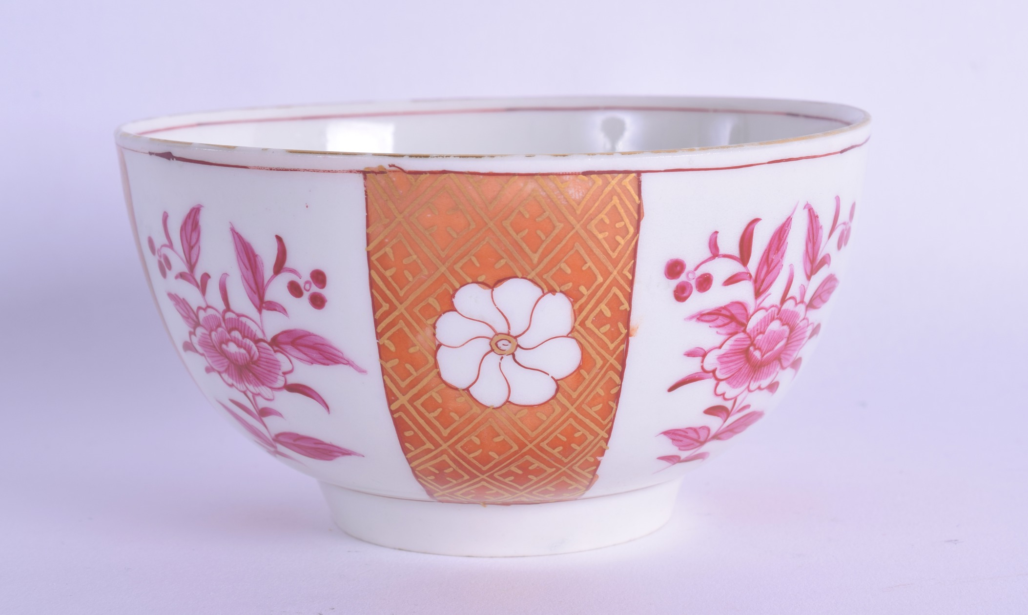 Lot 128 - 18th c. Worcester bowl painted with oriental flowers painted in puce between orange gilded bands