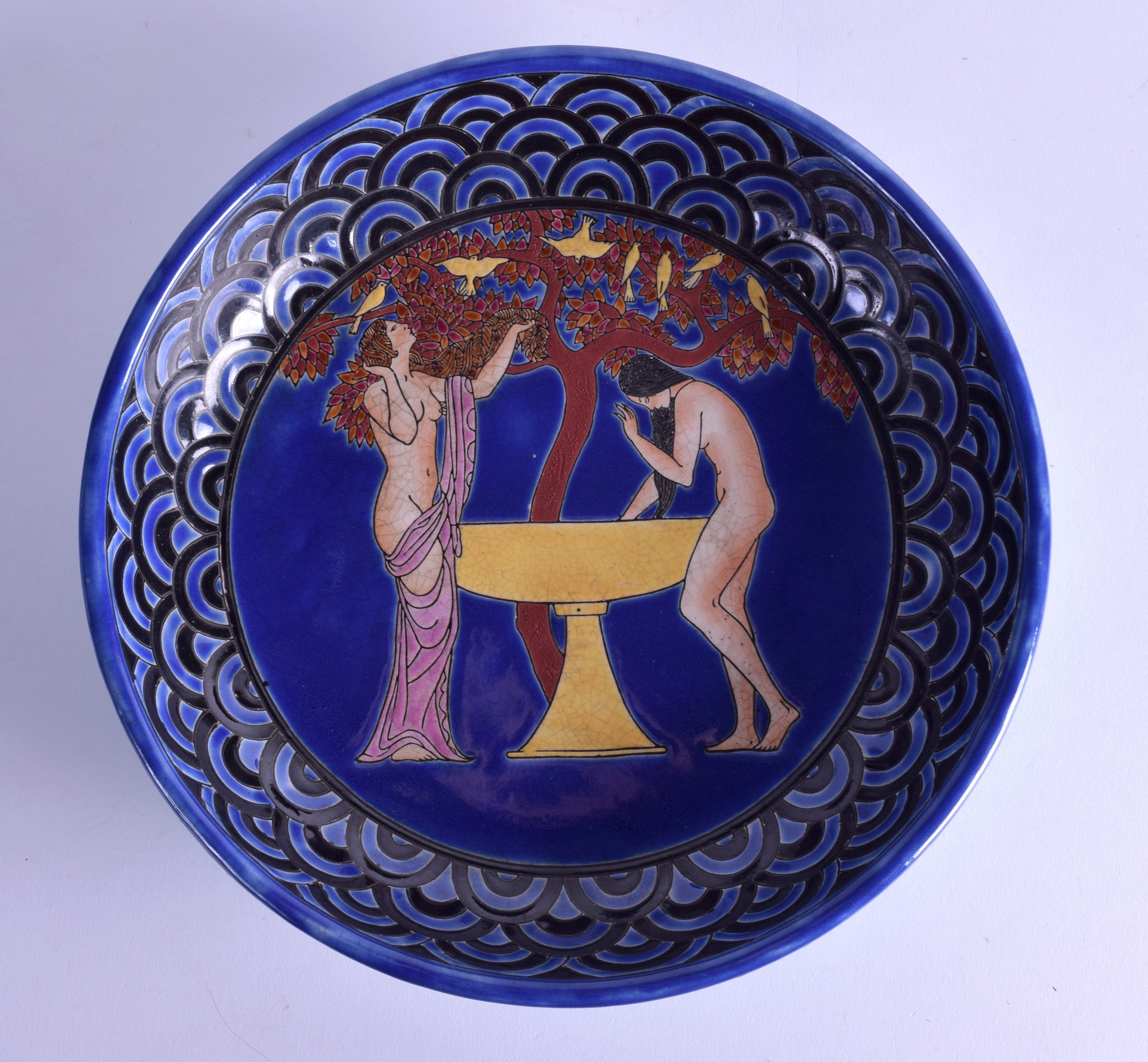 Lot 102 - AN ART DECO FRENCH KERALOUVE CIRCULAR POTTERY BOWL painted with two nude bathing females beside a