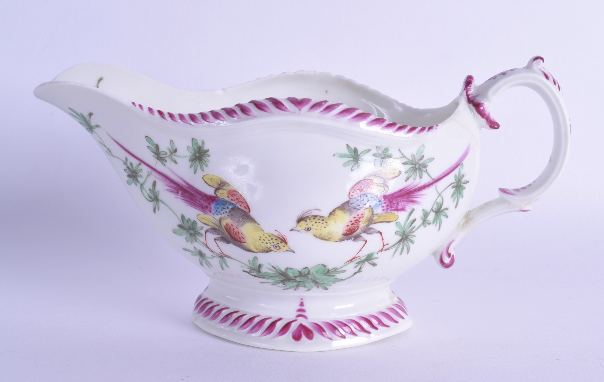 Lot 149 - 18th c. Worcester rare sauceboat of gadroon shape painted with two birds on branches to each side