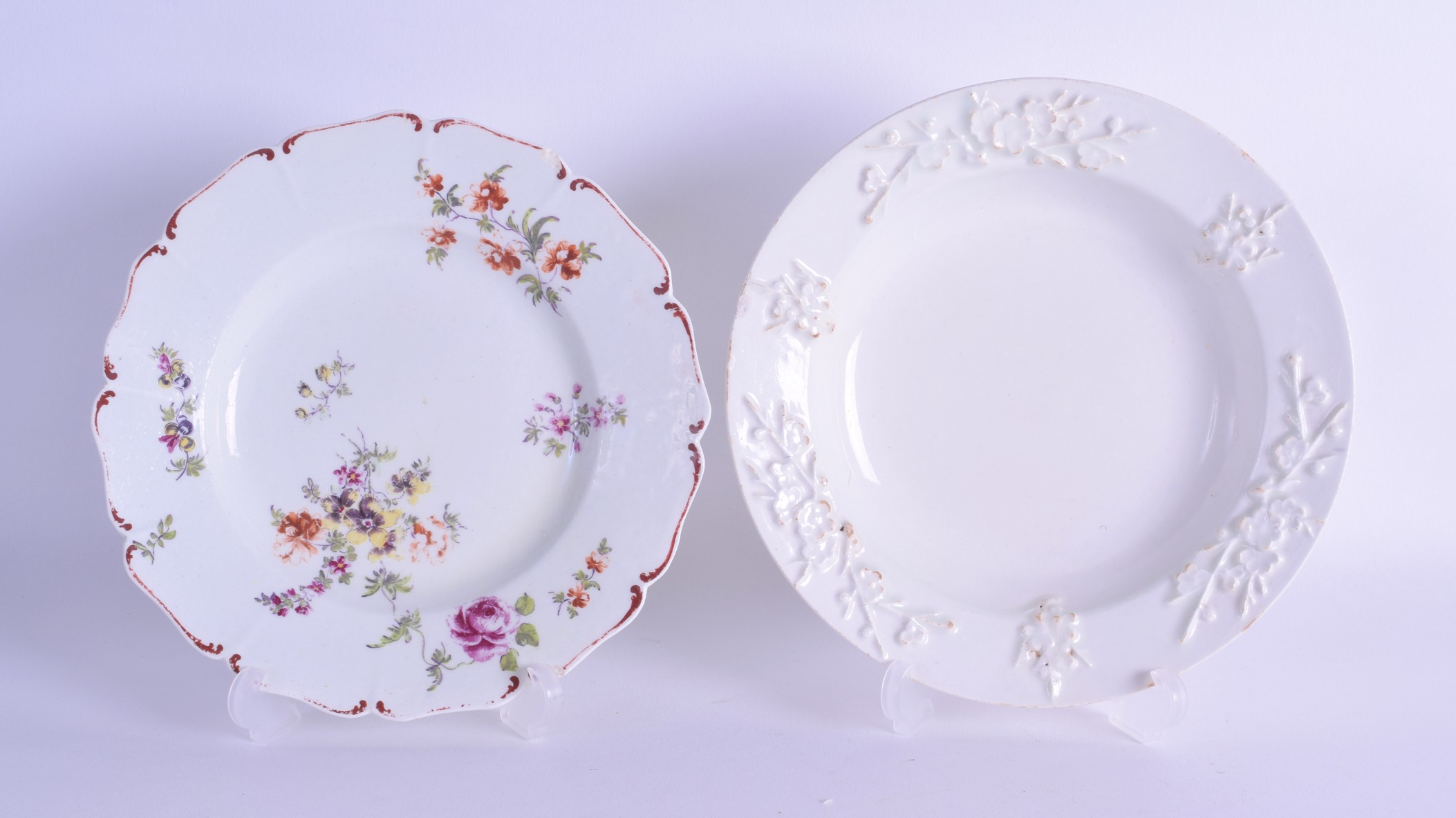 Lot 121 - An 18th c. Bow pudding basin in blanc di chine with moulded prunus decoration and a Derby small