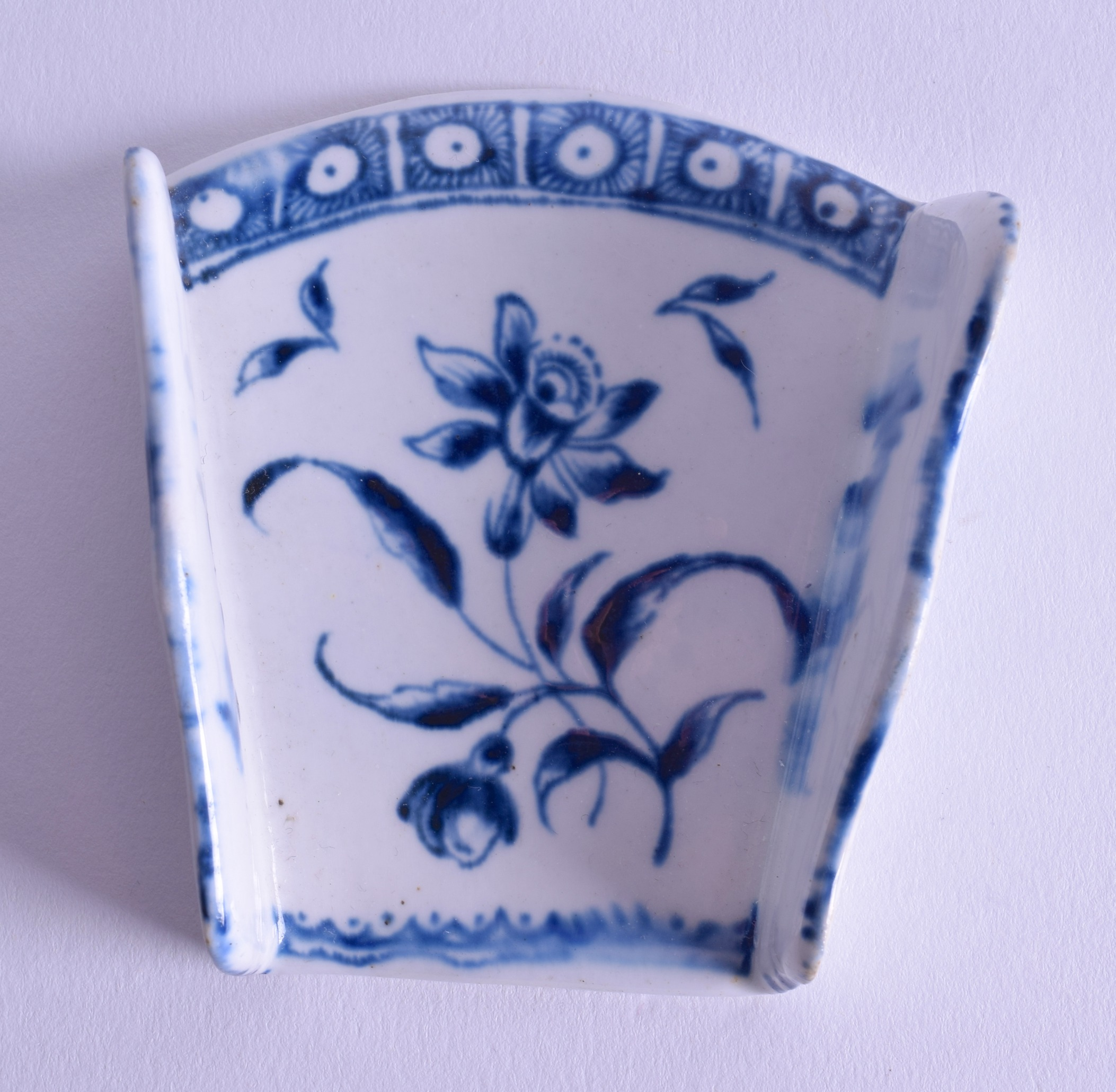 Lot 151 - 18th c. Derby asparagus server painted with a Narcissus under a cell border. 7.5cm tall