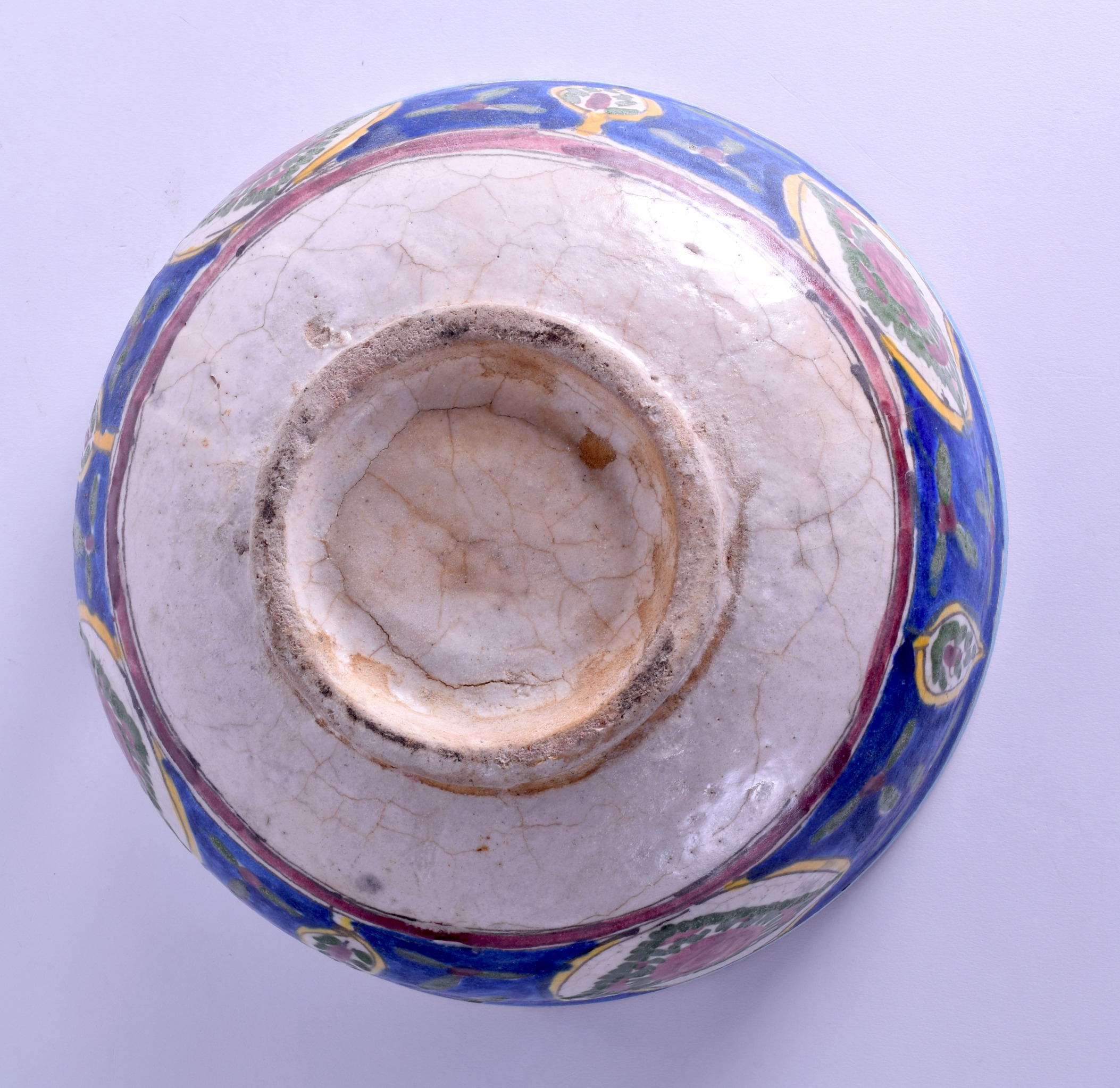 Lot 111 - A LARGE EARLY 20TH CENTURY PERSIAN POTTERY BOWL painted with fish and motifs. 31 cm diameter.