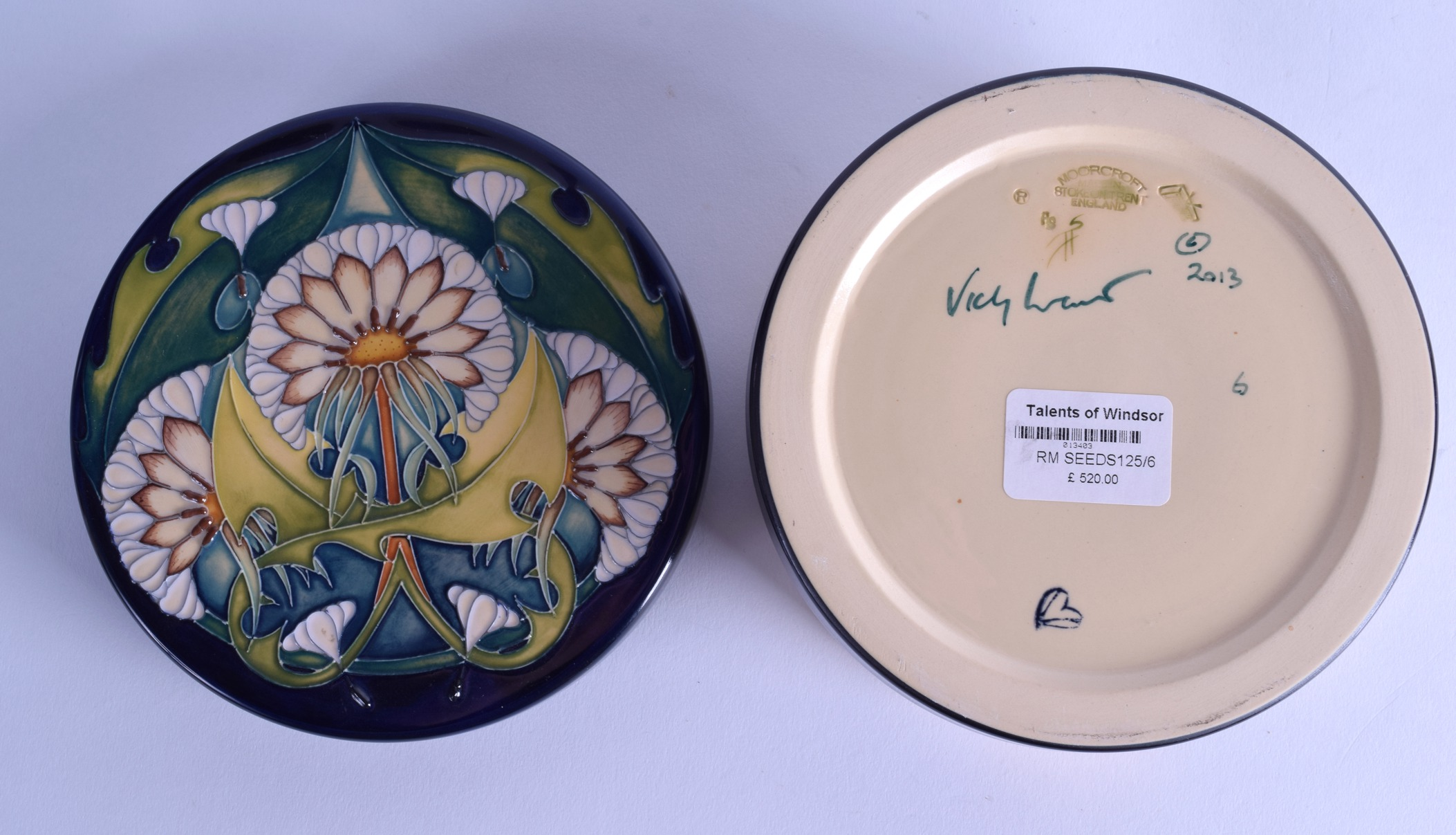 Lot 45 - A MOORCROFT 'SEEDS' LIDDED BOX AND COVER designed by Vicky Lovatt. 16 cm diameter.