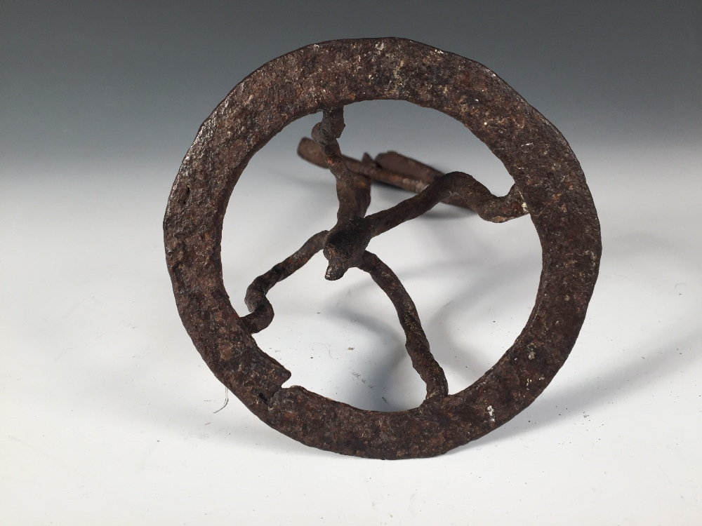 Lot 640 - An 18th century rushlight, Co. Sligo, the four legs forming a crown above the circular foot, the