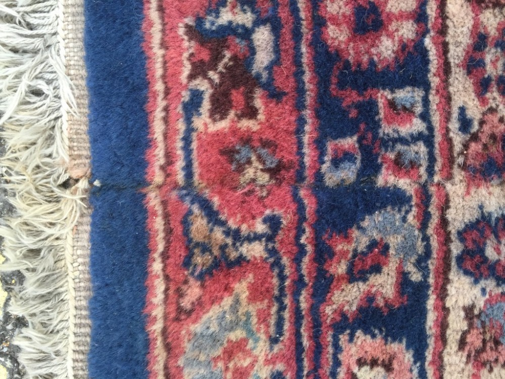 Lot 863 - A Sparta blue ground carpet, decorated with branch and foliate designs within a dark pink border 597